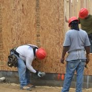 Workers Use a Nail Gun