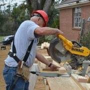 Man Cuts Wood With DeWalt Chop Saw