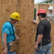 Volunteers Affix Plywood