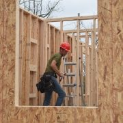 Volunteer Climbs a Ladder
