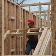 Volunteer Frames a House